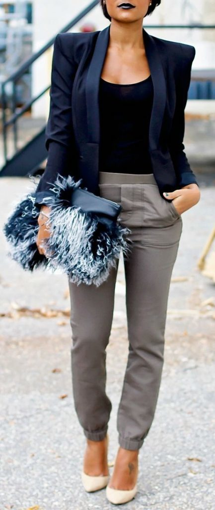 15-grey-trousers-a-black-top-a-navy-shoulderpad-jacket-and-a-fluffy-clutch