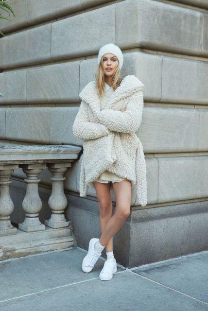 monochromatic look: white beanie, hooded/large collar white teddy bear coat, white mini dress, white sneakers
