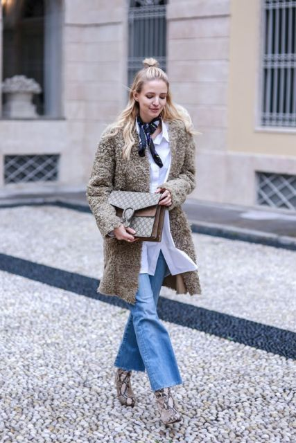 oversized white shirt, scarf, brown clutch, flared jeans, snake print ankle boots