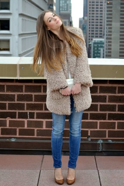 pastel teddy bear coat, skinny jeans, brown pumps, clutch