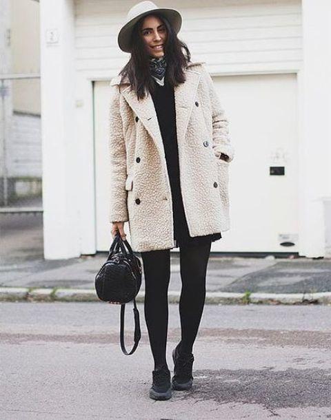 mini black dress, black stockings, black sneakers, felt hat, small handbag